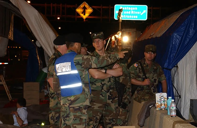 Dr. James Geiling (back to camera, in the blue vest), at the time an Army colonel in charge of the Pentagon's DiLorenzo Tricare Health Clinic, directs the medical response after the terrorist attack on the Pentagon on Sept. 11, 2001.
