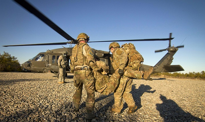 Airmen from the 227th Air Support Operations Squadron carry a simulated casualty to an Army Dustoff helicopter.