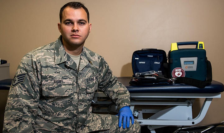 Air Force Staff Sgt. Geoffrey Rigby, 56th Medical Operations Squadron physical therapy technician, poses in front of emergency medical equipment. Rigby helped to save a life using his medical knowledge and training in Glendale, Arizona. (U.S. Air Force photo by Airman 1st Class Alexander Cook)