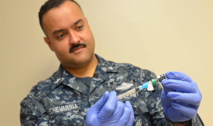 Navy Petty Officer 3rd Class Luis Echevarria draws up the new vaccine for shingles at Naval Hospital Jacksonville, Florida.  Shingrix is recommended for healthy adults 50 and older even if they've already had shingles or received the previous shingles vaccine. (U.S. Navy photo by Petty Officer 1st Class Jacob Sippel)