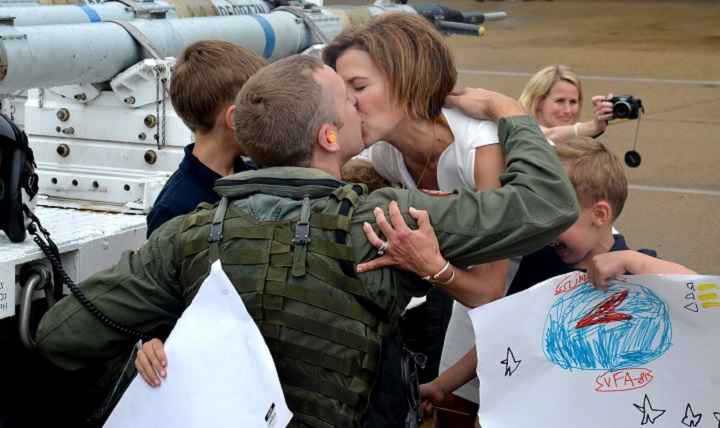 A pilot is greeted by his family during a homecoming celebration at Naval Air Station, Oceana. (U.S. Navy photo by Mass Communication Specialist 2nd Class Alysia R. Hernandez)