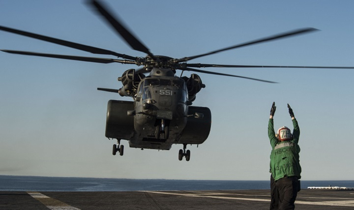 An MH-53E Sea Dragon helicopter prepares to land on the flight deck of the aircraft carrier USS Dwight D. Eisenhower.
