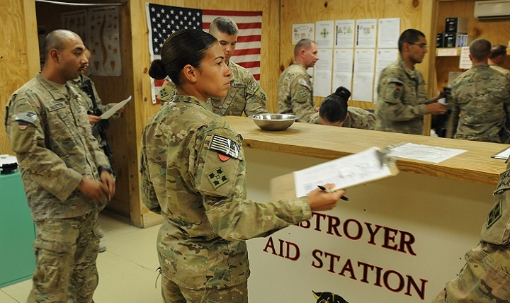 Army Sgt. Liliane Milo, a medic with 4th Infantry Division, checks in Soldiers for Military Acute Concussion Evaluations.