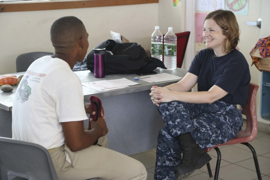 Lt. Cmdr. Mary Rhodes, a psychiatrist, talks with a patient. (U.S. Army photo by Spc. Lance Hartung)