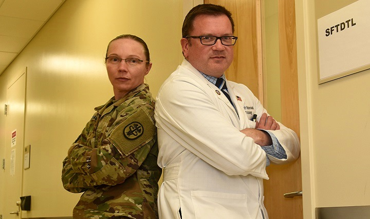 U.S. Army Maj. Lynn Wagner, Armed Forces Medical Examiner System Division of Forensic Toxicology Special Forensic Toxicology Drug Testing Facility chief (left), and Dr. Jeffrey Walterscheid, AFMES Division of Forensic Toxicology chief toxicologist, pose for a photo. Wagner and Walterscheid want to let service members know they are watching and making sure they do not get away with doing synthetic cannabinoids. (U.S. Air Force photo by Senior Airman Ashlin Federick)