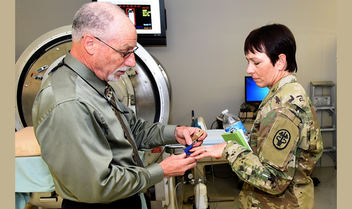 U.S. Army Institute of Surgical Research senior scientist, Victor Convertino, Ph.D. (right), demonstrates the functions and capabilities of the Compensatory Reserve Index to Army Maj. Gen. Barbara Holcomb, commanding general, U.S. Army Medical Research and Material Command. (U.S. Army photo by Steven Galvan)