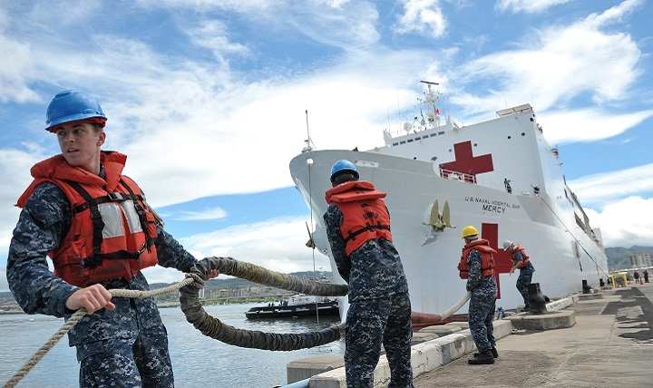 Sailors assigned to Joint Base Pearl Harbor-Hickam handle line as the hospital ship USNS Mercy moors at JBPHH. Mercy is deployed in support of Pacific Partnership 2016.