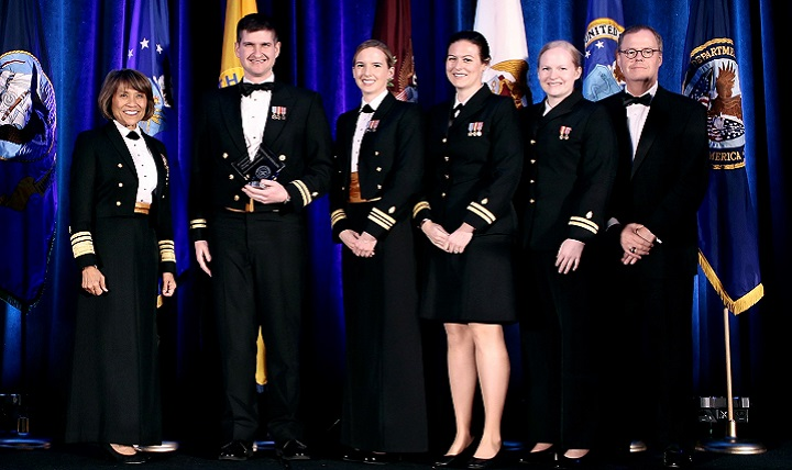 "MHS ""Advancements towards High Reliability in Health Care"" Awards: Healthcare Quality and Patient Safety Awards - Walter Reed National Military Medical Center for ""High Value Cost Conscious Care: Optimizing the Electronic Medical Record to Reduce Unnecessary or Redundant Lab Orders."" Pictured (left to right) are Navy Vice Adm. Raquel Bono, director, Defense Health Agency, Navy Lt. Brett Sadowski, Navy Lt. Cmdr. Alison Lane, Navy Lt. Sara Robinson, Navy Lt. Nora Maddy and Tom McCaffery, acting Assistant Secretary of Defense for Health Affairs. (Courtesy photo)"