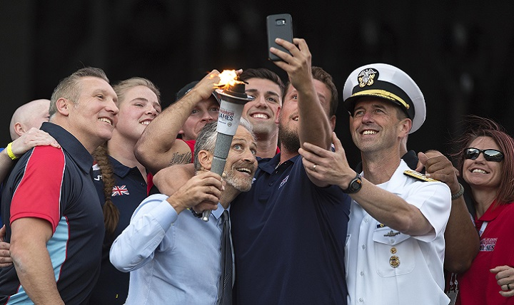 Television and movie personality, director, and writer Jon Stewart poses for a selfie with Chief of Naval Operations Adm. John M. Richardson and wounded warrior athletes during opening ceremonies for the 2017 Department of Defense Warrior Games at Soldier Field in Chicago, July 1, 2017. (DoD photo by EJ Hersom)