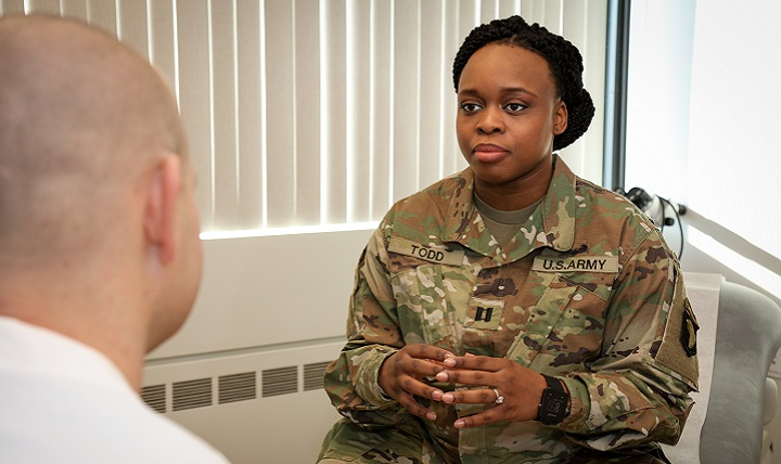 Army Capt. Ebony Todd, legal advisor at Fort Campbell, discusses her pregnancy with Army Capt. (Dr.) David Tillman, Blanchfield Army Community Hospital OB-GYN provider. (U.S. Army photo by David Gillespie)
