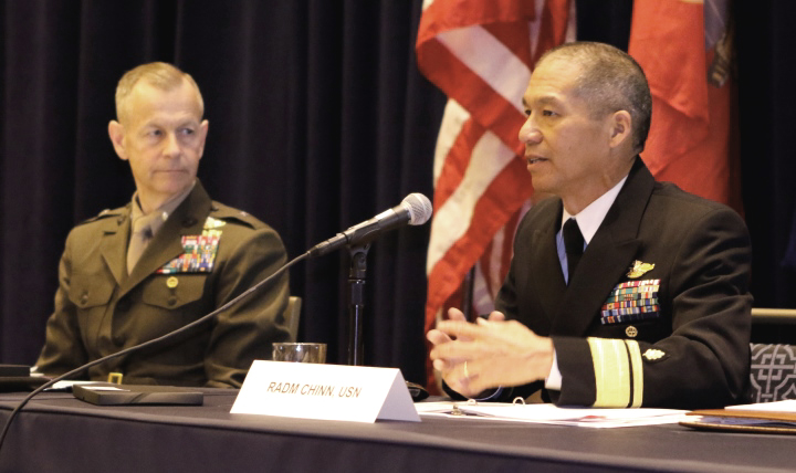 Navy Rear Adm. Colin Chinn, the acting deputy director of the Defense Health Agency, talked about battlefield medicine innovations as Rear Adm. Stephen Pachuta, Medical Officer of the Marine Corps watched, during a combat survivability panel at the Navy League's Sea-Air-Space exposition, April 5, 2017, at National Harbor just outside of Washington, D.C. Others on the panel (not pictured)included Navy Surgeon General Vice Adm. Forrest Faison; Rear Adm. Cathal O'Connor, commander, Expeditionary Strike Group THREE; and Rear Adm. Tina Davidson, director Medical Resources, Plans, and Policy at the Navy's Bureau of Medicine.