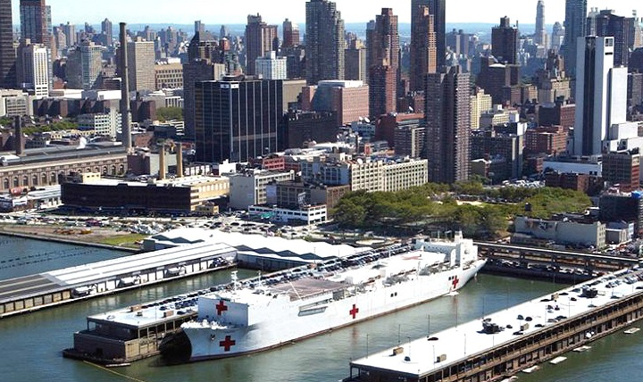 The 'Floating Hospital,' the USNS Comfort docks at Pier 92 on the west side of Manhattan at about 8:30 p.m. on Sept. 14, 2001 with 300 Navy medical personnel, mostly from National Naval Medical Center, Bethesda, Maryland [now Walter Reed Bethesda]. (U.S. Navy photo)