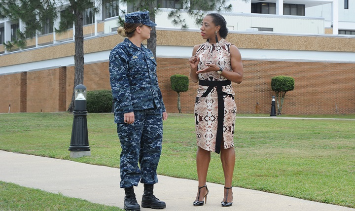 Laticia Jackson, a health educator, talks to a patient. Symptoms of communication disorders after a TBI can differ depending upon the type and severity of the injury. For many, problems with communication are the result of difficulties with attention and memory, such as not being able to follow a conversation, not with the ability to speak. (U.S. Navy photo by Jason Bortz)