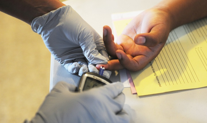 A Soldier performs a glucose screening. A person diagnosed with diabetes is lacking insulin or is insulin resistant so that the body can't process sugars normally. (U.S. Army photo by Sgt. Jessica A DuVernay)