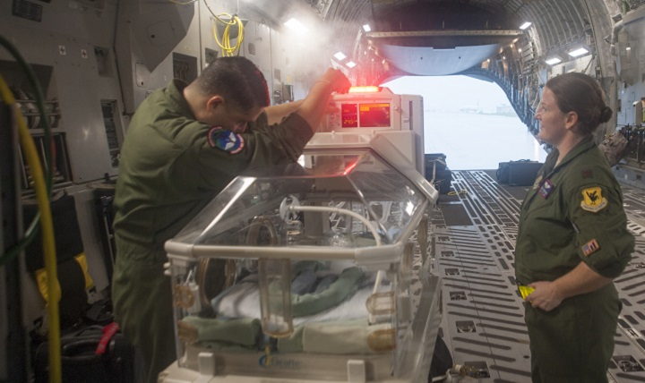 "Air Force Staff Sgt. Angel Figueroa, 18th Medical Operations Squadron technician, (left) and Maj. Melissa Dassinger, 18th Aerospace Evacuation Squadron Training Flight commander, test a ""Giraffe"" omnibed at Kadena Air Base, Japan. A C-17 Globemaster III can be equipped with materials and systems required to transport injured patients across great distances quickly and safely. (U.S. Air Force photo by Senior Airman Quay Drawdy)"
