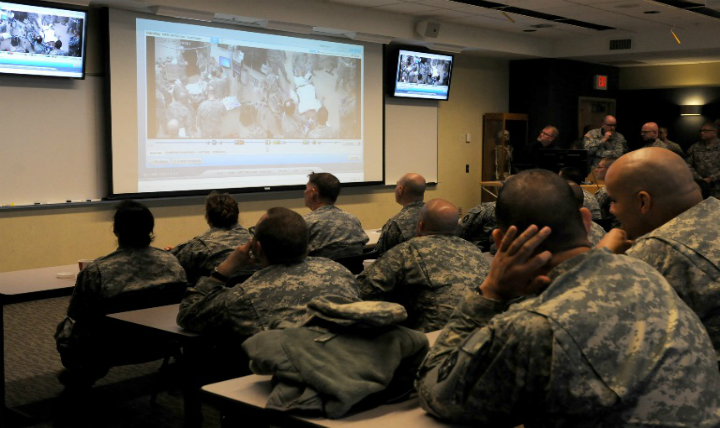 Soldiers from the 399th Combat Support Hospital, 804th Medical Brigade, 3d Medical Command (Deployment Support) watch video footage of their performance during an exercise held April 2, 2016 at the Mayo Clinic Multidisciplinary Simulation Center in Rochester, Minnesota. The unit's every move was recorded at the facility, which allowed them to review and improve their performance throughout the course of the exercise. During the exercise, the unit, which is based out of Fort Devens, Massachusetts, practiced the Team Strategies and Tools for Enhanced Performance and Patient Safety, or TeamSTEPPS, model of patient care. TeamSTEPPS is a framework implemented by the Department of Defense to optimize performance of military medical teams and reduce communication errors that can result in improper patient care. (Photo by: Staff Sgt. Andrea Merritt)