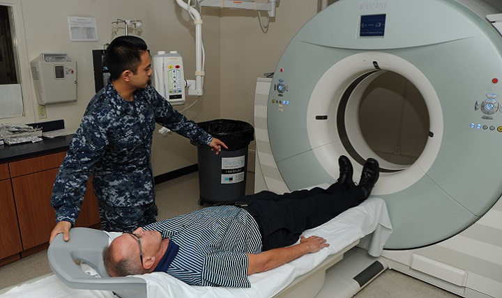 A patient at Naval Hospital Pensacola prepares to have a low-dose computed tomography test done to screen for lung cancer. Lung cancer is the leading cause of cancer-related deaths among men and women. Early detection can lower the risk of dying from this disease. (U.S. Navy photo by Jason Bortz)