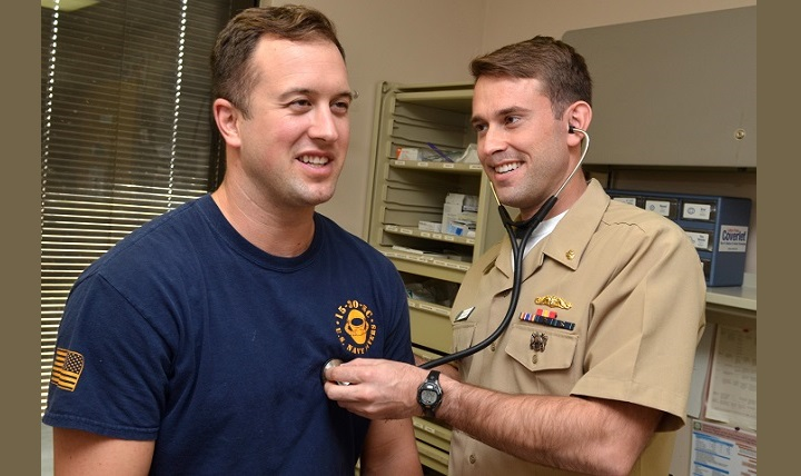 Navy Lt. Blair Townsend, Naval Branch Health Clinic, Kings Bay undersea medical officer, checks the heart rhythm of Navy Fire Control Technician 1st Class Nicholas Mershon, from USS Georgia.