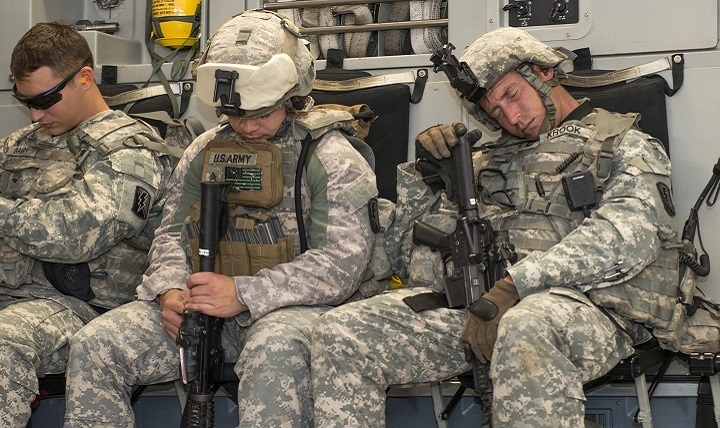 Army Soldiers catch a few minutes of sleep on board an Air Force C-17 Globemaster III.