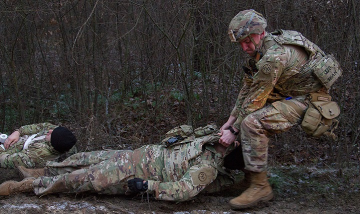 Army Spc. Caleb Bailey, a combat medic assigned to the Joint Multinational Training Group – Ukraine moves a casualty during a mass casualty exercise. The Defense Department and Food and Drug Administration jointly launched a program, Jan. 16, 2018, to expedite developing and delivering new medical products to the warfighter. (U.S. Army photo by Sgt. Alexander Rector)