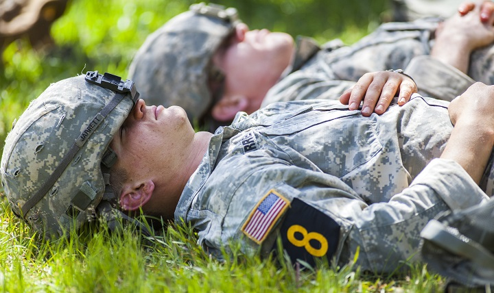 U.S. Army Rangers, rest for a moment in between events during the Best Ranger Competition 2016, at Fort Benning, Ga., April 16, 2016. The competition is a three-day event consisting of challenges that test competitor's physical, mental, and technical capabilities. The Rangers compete for nearly sixty hours with little or no sleep, and must rest intermittently for minutes at a time while waiting to begin their next event. (U.S. Army photo by Staff Sgt. Justin P. Morelli)