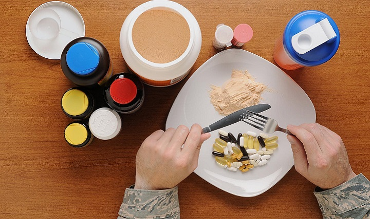 """The supplement business is a multi-billion dollar industry that is not currently regulated like conventional food and drug products by the Food and Drug Administration. Not only are they potentially unsafe, weight-loss supplements that advertise """"quick fixes"""" likely won't help you meet your goals. (U.S. Air Force photo illustration by Airman 1st Class Daniel Brosam)"""